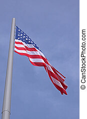 United States flag over blue sky