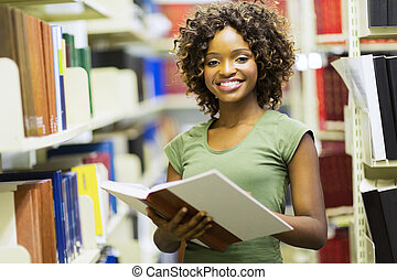 female african american student in library - smiling female...