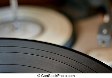 Gramophone vinyl record against old record player in the...
