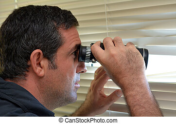 Man Spy - Man age 35-40 looks and searches with binoculars...