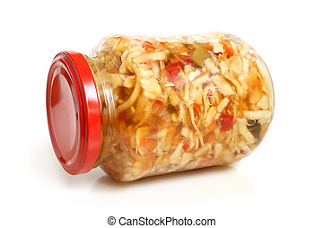 Preserved cabbage and red paprika salad in glass jar