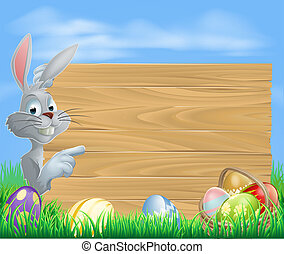 Easter rabbit pointing at message - Easter white bunny...