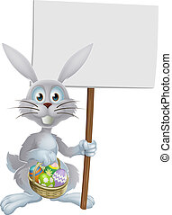 White Easter rabbit holding sign - White Easter rabbit...