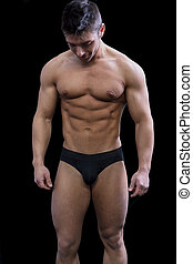Muscular young man semi naked looking down - Muscular young...