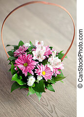 Beautiful bouquet of spring flowers in basket isolated on...