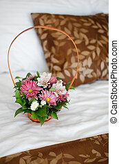 Beautiful bouquet of colorful flowers in basket against the...