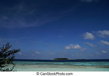 variations of blue - look from a maldivian Island at the...