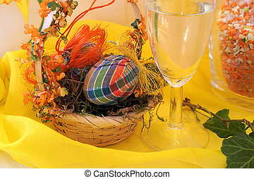 easter-decoration - easteregg in a nest and an empty...