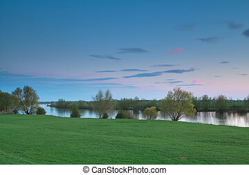 calm sunset over river Ijssel - calm sunset over river,...
