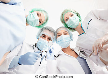 group of doctors in operating room - picture of young team...