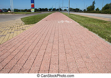 brick paved bikeway at side of the street