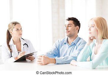 doctor with patients in cabinet - bright picture of doctor...