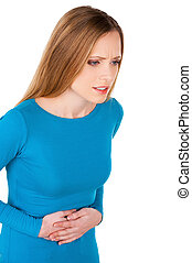 Indigestion. Frustrated young woman holding hands on stomach...