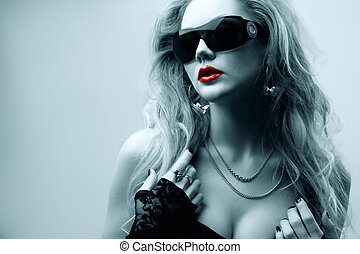 oung woman wearing sunglasses - portrait of young woman...