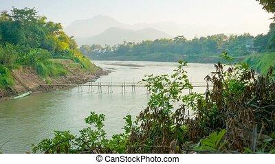 Old bamboo bridge across the river. Laos, Luang Prabang