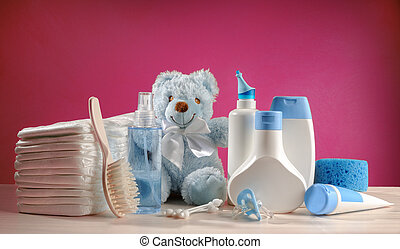 toiletries baby with diapers and pacifiers, and pink...