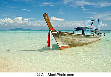 Beautiful image Longtail boat on the sea tropical beach....