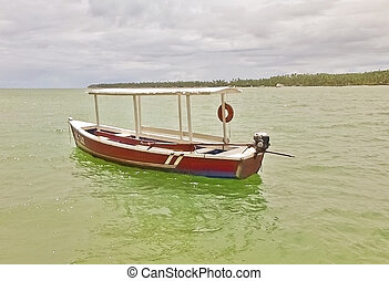 Lonely Rustic Boat in the Sea - Old and little rustic boat...