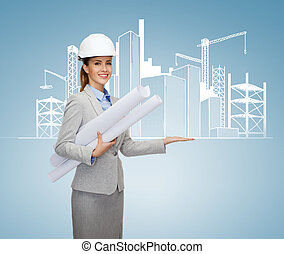 smiling architect in white helmet with blueprints -...