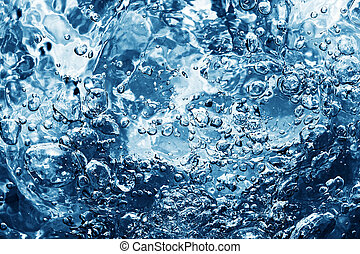 Clean water with bubbles appearing when pouring water or a...