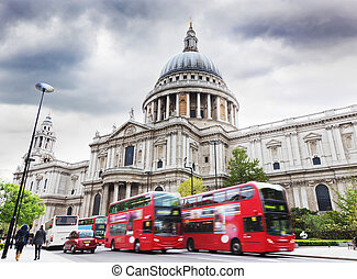 St Pauls Cathedral in London, the UK Red buses, cloudy sky -...