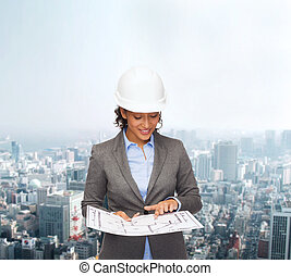 businesswoman in white helmet with blueprint - building,...