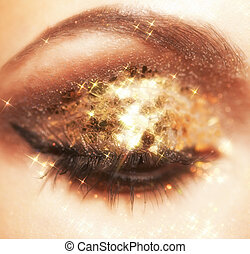 Shining eye makeup - Soft focus portrait of female eye with...