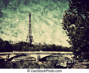 Eiffel Tower and bridge on Seine river in Paris, France. View from Alexandre Bridge in vintage, retro style