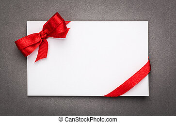 Card with red ribbons bows