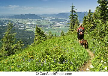 A hiker and his best friend - A male hiker and his dog stop...