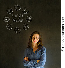 Business woman or teacher with social media icons chalk...