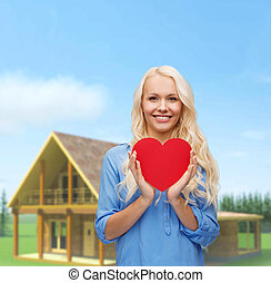 smiling woman with red heart - happiness, health and love...
