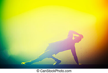 Hip hop, break dance performed by young man in colorful club...