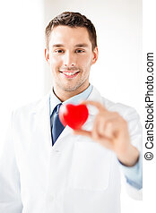 male doctor with heart - bright picture of male doctor with...