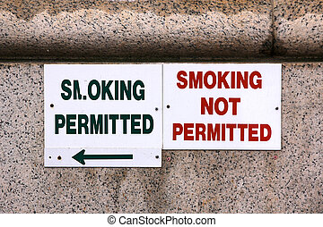 Smoking Signs - Two signs marking the border between the...