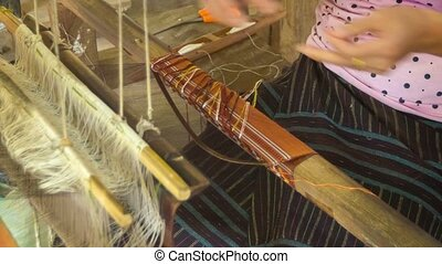 Woman working on a loom. Laos - Video 1920x1080 - Woman...