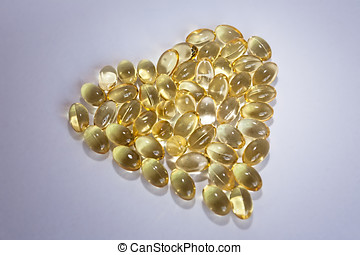 Cod liver oil Omega 3 gel capsules in the form of heart...
