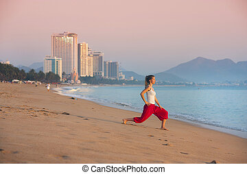 Sport woman doing exercise at the city beach - Sport active...