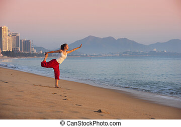Sport woman doing exercise at the city beach. - Sport active...
