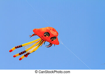 Octopus kite on blue sky