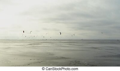 snowkiting time Lapse - frozen sea many snowkiting in the...