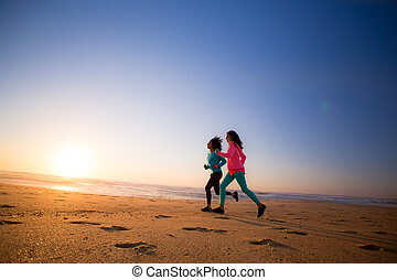 Women running - Couple of women running and walking on the...