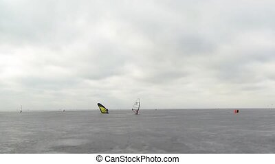 Ice racing windsurfing like moths - winter race windsurfer...