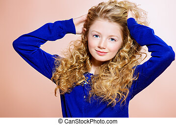 wealth of hair - Portrait of a smiling girl with beautiful...