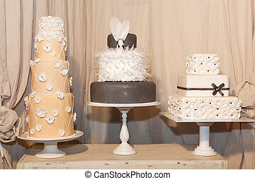 Three elegant wedding cakes