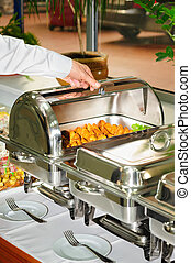chafing dish heater with grilled meat - chafing dish heater...