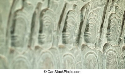 Ancient carvings on the walls of Angkor Wat close up...