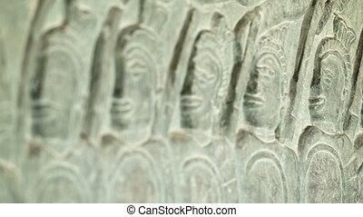 Ancient carvings on the walls of Angkor Wat close up....