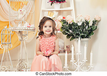 Beautiful little lady posing in vintage interior