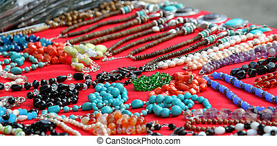 many jewelry and gemstone necklaces for sale at a jewelry store in Italy